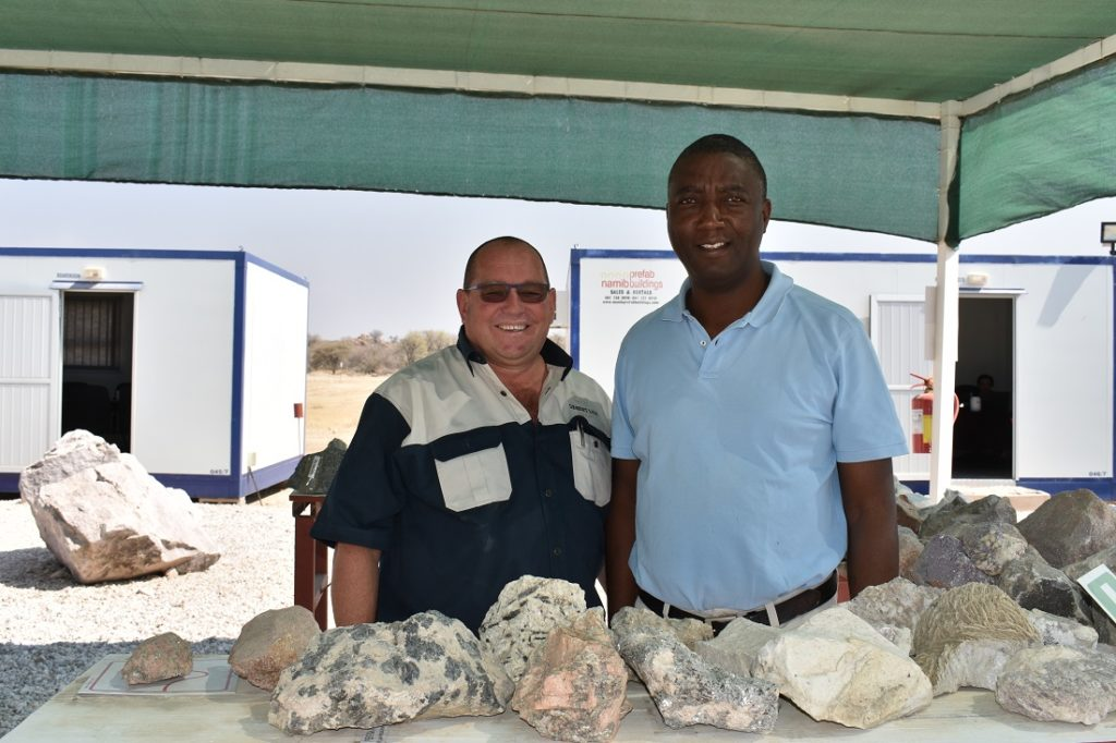 DSC_0010 - Johan Coetzee, chief operating officer of Desert Lion Energy (on the left), and Simon Kahovera, exploration manager and chief geologist at Desert Lion Energy, at their collection of rocks and minerals. Image credit: Leon Louw